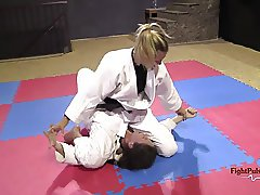 Girls wrestling in kimonos (pindown match)