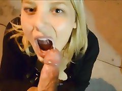 Blonde sucking cock on street with facial
