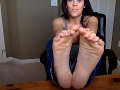 beautiful brunette shows her soles and toes