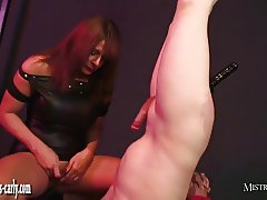 Mistress spanks and fucks slaves ass with huge black dildo