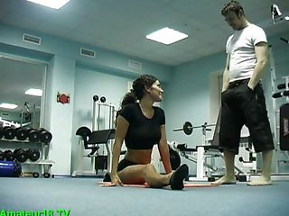 Acrobatic babe fucked during workout