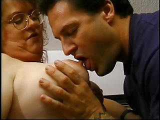 Old slut gets her plump tits sucked by stud