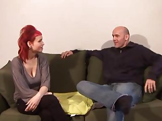 Natural busty redhead fucks on the sofa with boyfriend