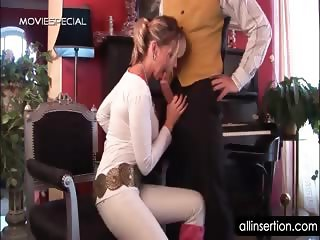 Hot teacher blows her student\'s dick and rubs twat
