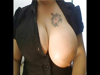 Milf teasing with her big boobs