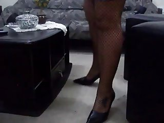 Latina Fishnet Legs Crossed