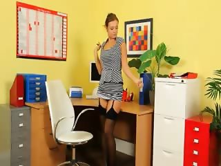 Ultra sexy secretary stripping in office