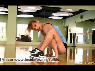 Anita _ Amateur redhead babe acting naughty at the gym