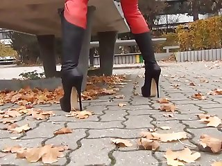 Red leather catsuit and 8 inch stilletoe boots