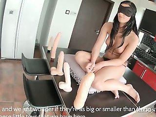 Blindfolded sweet brunette playing with hot sex toys