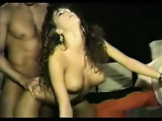 Beautiful brunette milf eating cock