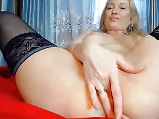 Blonde rubs pussy with balls in ass
