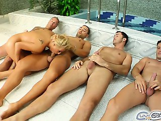 Four horny cocks attack Myra's throat. She polishes each one and gets into position for the famed cum covering. Each guy releases his load on her face