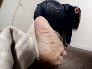 Mature stinky socks and wrinkled soles