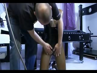 Attractive slave girl getting tied up