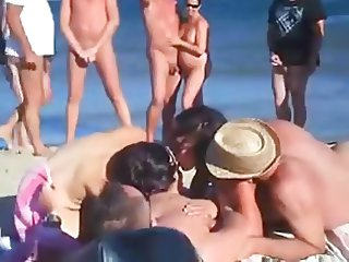 four friends have sex on nude beach in front of crowd