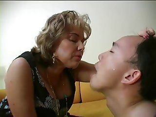 Dominant French woman spits in her slaves mouth