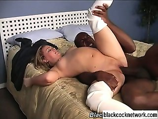 Blonde slut in white boots fucks huge black cock