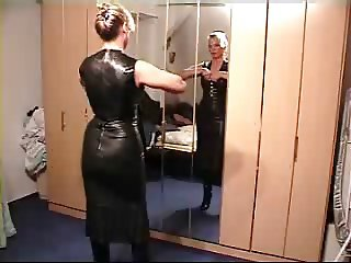 Lady putting on leather clothes