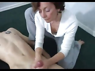 Woman wanking off a young man!