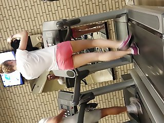 Hot blond girl on threadmill running with thong