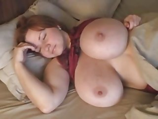 Massive breasts of a beautiful redhead.