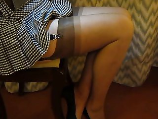 Lovely short pleated skirt and stockings.