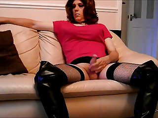 Tranny in thigh boots playing with her big stiff cock