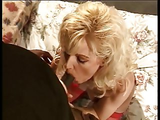 Bald-headed black stud licks a curvy blondes pussy and ass from behind