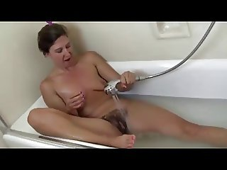 little saggy tits, hairy pussy,pits gets off with shower