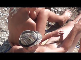 Voyeur. Girl Jerks Off guy dick on a public beach