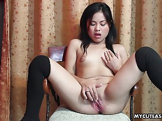 Slutty little Asian lady drilling her smooth cunt with a dil