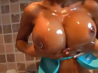 Fernanda Ferrari Rubs Oil On Her Sexy Body