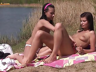 Horny scoolgirl making dildo party at the lake side.