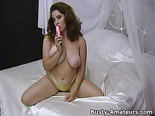 Busty Jonee striptease and masturbates her hairy pussy