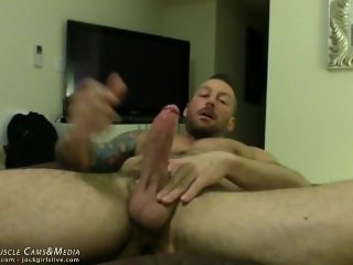 Hugh Hunter Strokes his giant cock at JockMenLive.com