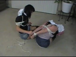 Two girls tied up and gagged in socks