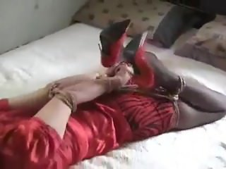 Hogtied and ball gagged in red outfit and heels
