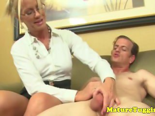 Mature doctor milf with tattoos tugging on cock
