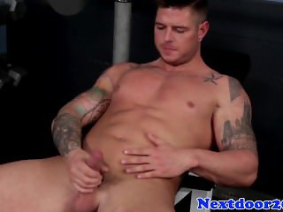 Muscular tattooed stud jerking off