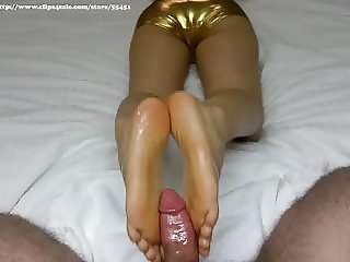 Asian in shiny gold hot pants gives oily foot job