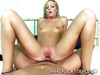 Blonde whore mounts a huge fat cock with her tight ass hole