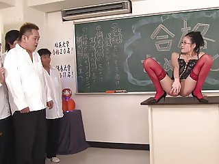 Geeky slut gets threesome fuck in the classroom