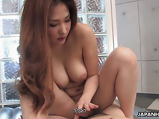 Busty Asian babe teasing the hell out of his cock