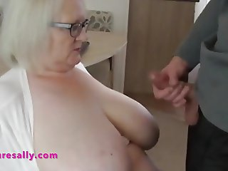 Jacking off over Sally's huge tits