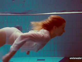 Cute Melissa plays underwater