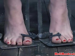 Bound slave dominated with toy by master