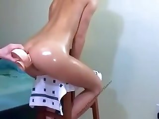 successful insertion of huge dildo in her ass