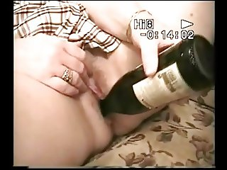 Women in long socks fuck herself with bottle