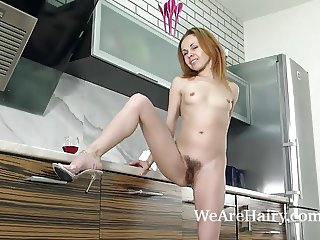 Liliya strips naked and oils her body in kitchen